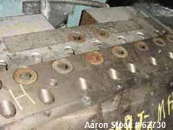 http://www.aaronequipment.com/Images/ItemImages/Plastics-Equipment/Dies-Sheet-Dies/medium/Cloeren_62730_a.jpg