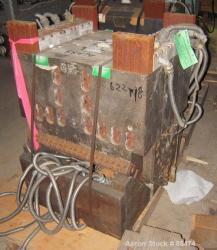 http://www.aaronequipment.com/Images/ItemImages/Plastics-Equipment/Dies-Sheet-Dies/medium/Cloeren_88474_a.jpg