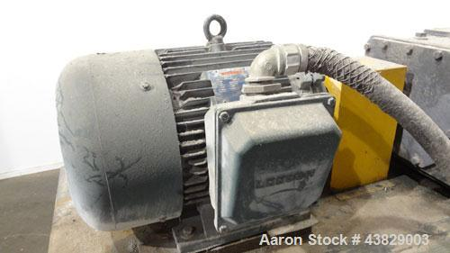 Used- Extrex Gear Type Melt Pump. Driven by a 40hp, 3/60/208-230/460 volt, 1780 rpm motor with a Falk Model 284AFXD2A RAM ge...