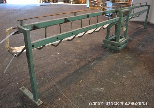 """Used- Profile Dump Table, Carbon steel. Approximately 222"""" long, air operated. Mounted on a frame."""