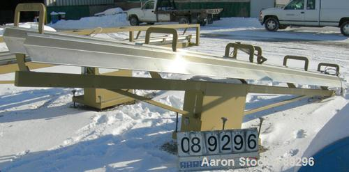 """USED: Royal Machine dual lane dump table, model 158. (2) 6"""" wide x 236"""" long pneumatically operated stainless steel rails. M..."""