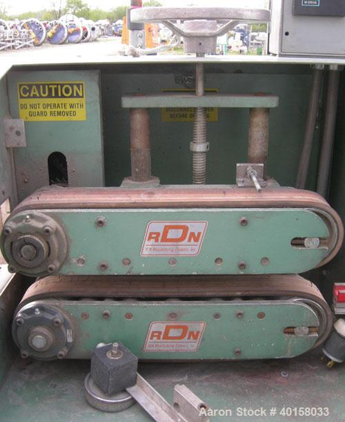 "Used- RDN belt puller, model 118-5A. 3"" wide x 20"" long contact length rubber belts, manually adjustable. Driven by a 2 hp,..."