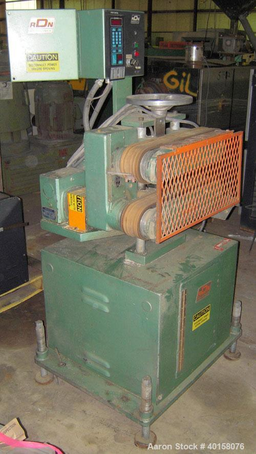 """Used- RDN belt puller, model 218-3. 3"""" wide x 18"""" long contact length belts, manually adjustable. Driven by a 1 1/2 hp motor..."""