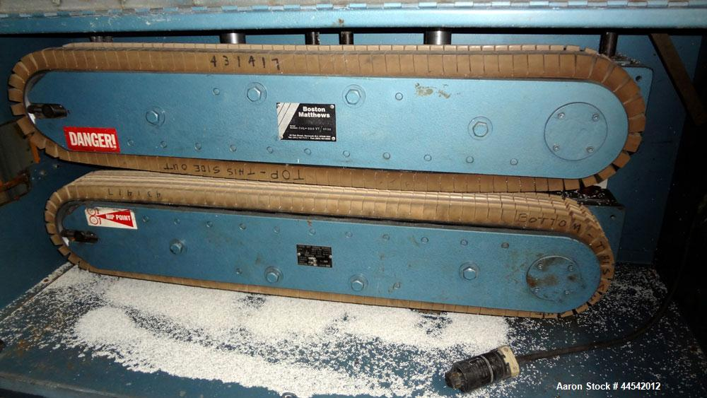 "Used- Boston Matthews Cleated Belt Puller, Model CWL-600-VT. (2) Approximately 4"" wide x 42"" long contact area belts, manual..."