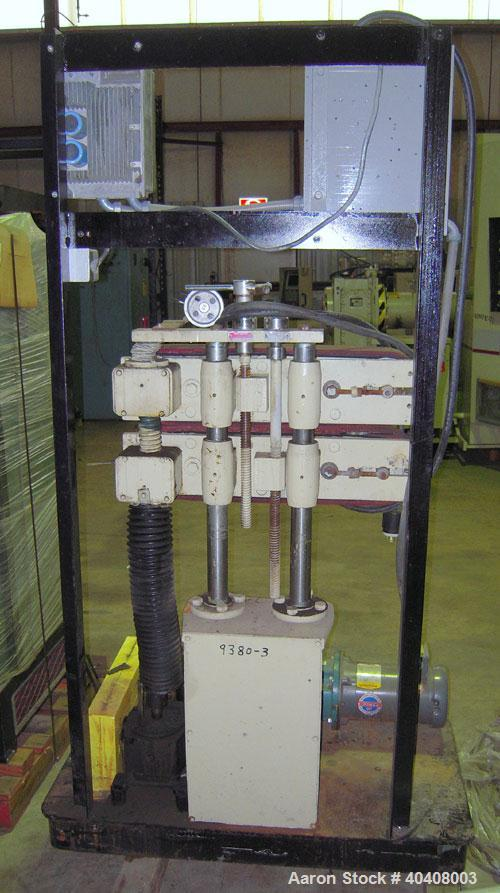"Used- Farris model C550VT belt puller having two approximately 4"" wide belts with 21"" of contact length. Belts are driven by..."