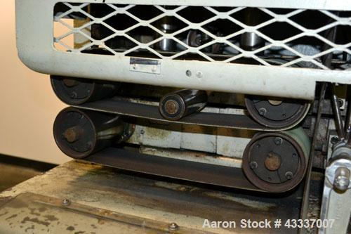 Used- Gatto Belt Puller, Model 205-4.(2) 4'' Wide x 16'' long contact lehgth rubber belts, manually adjustable. Base mounted...