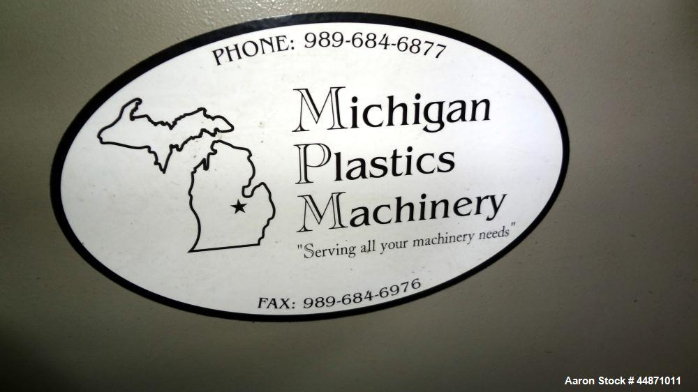 "Used- Michigan Plastics Machinery Puller.  (2) 5-1/2"" Wide x 49"" long contact cleated rubber belts.  Manually adjustable app..."