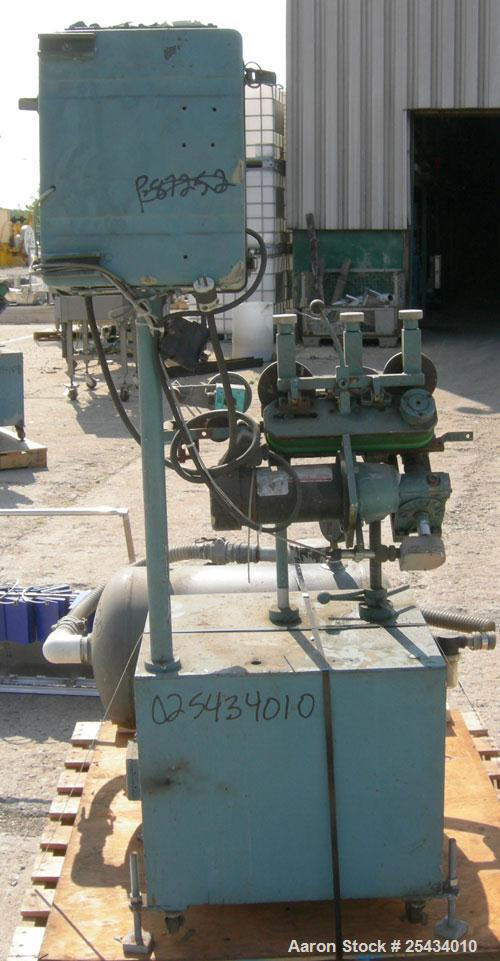 "Used-  Puller, ""V"" Shaped.  (2)  2"" wide x 12"" long belts.  Manually adjustable height.  Driven by a 1/2 hp, 90 volt, 1725 r..."