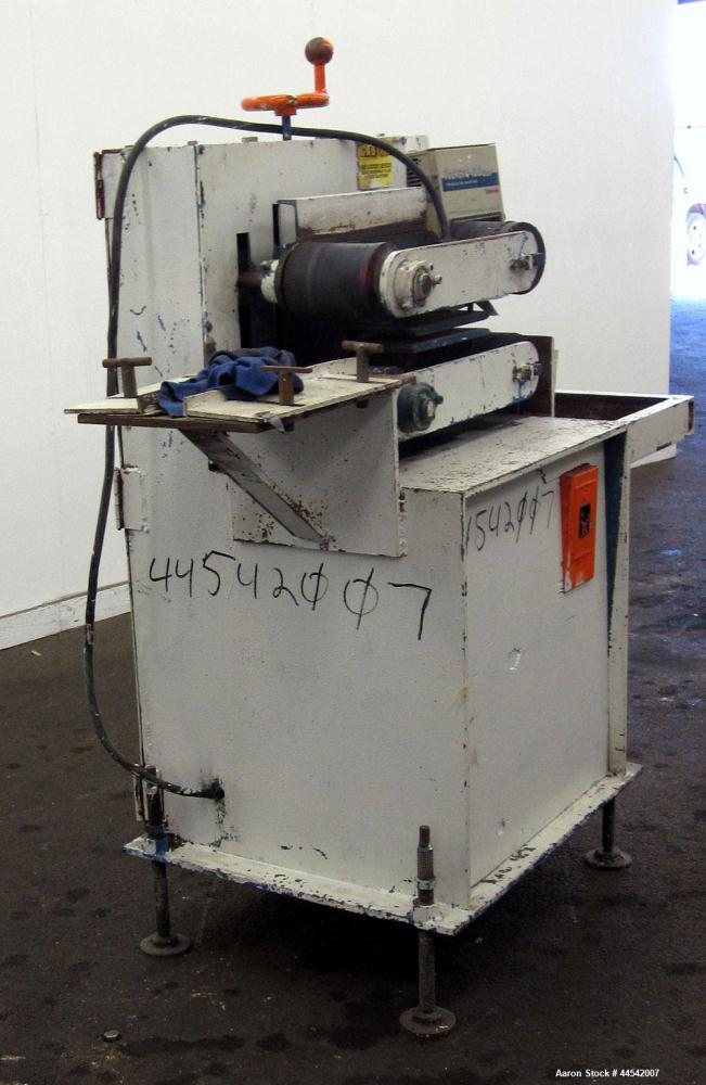"Used- Belt Puller. Requires (2) approximately 6"" wide x 22"" long contact area belts, manually adjustable, approximately 6"" m..."