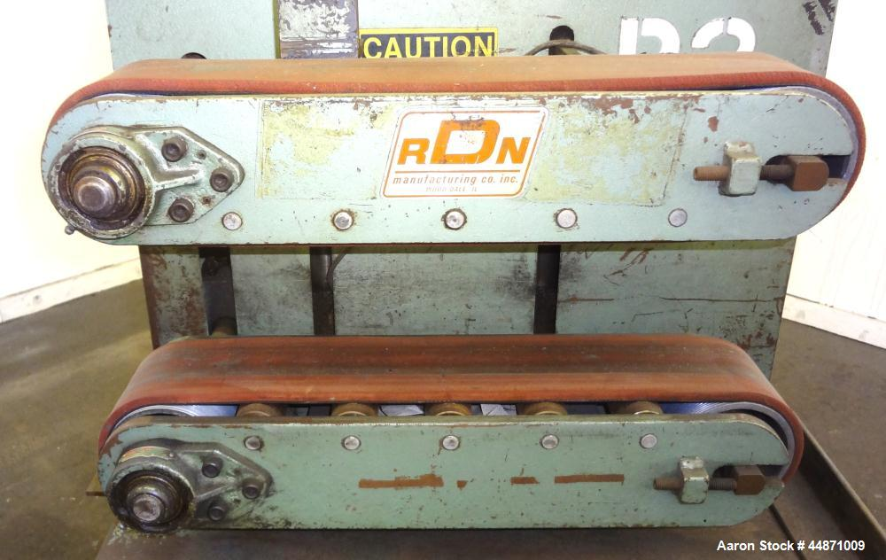 "Used- RDN Belt Puller, Model 118-5.  (2) Approximately 3.75"" wide x 18"" long contact area belts, manually adjustable, approx..."
