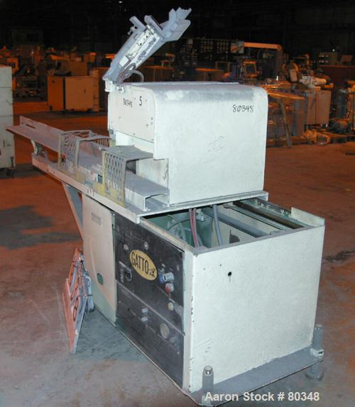 "USED: Gatto table saw, model CS.7.24. Unit can accept up to 4"" wide x 2"" tall or 2"" diameter product. Saw driven by 3 hp 3/6..."