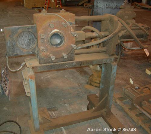 """Used- 6"""" Hydraulic Screen Changer. Mounted on a frame with casters. Requires power pack."""