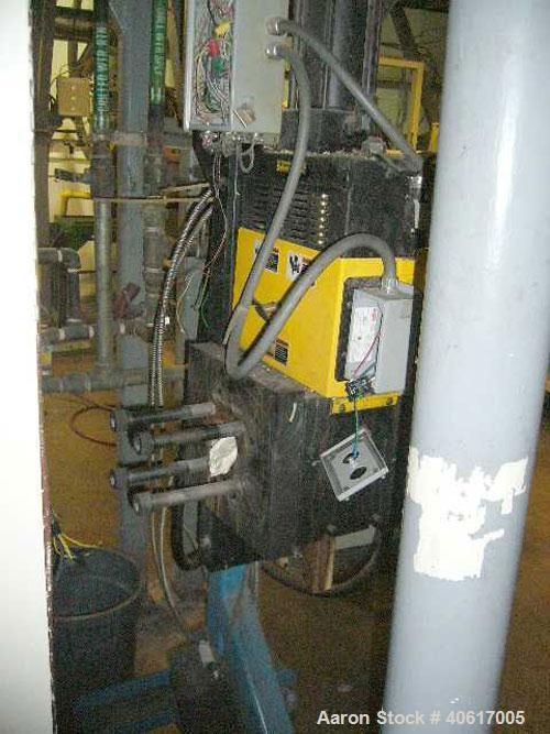"Used- Dynisco 4.5"" Hydraulic Screen Changer. Includes a stand and hydraulic pump."