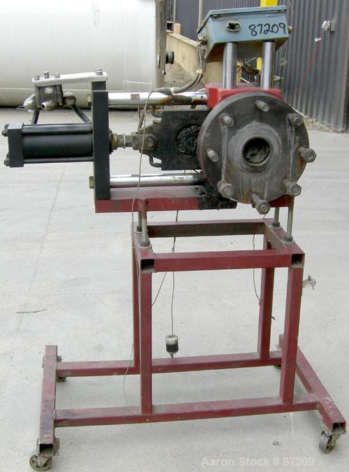 "USED: MGB 4.5"" hydraulic screen changer. No power pack. Mounted on a frame."