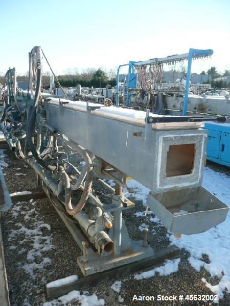 Used- Metaplast Vacuum Sizing Tank, Model MVS2-10-4, approximately 10' long. Equipped with (2) pumps. Serial#895009.
