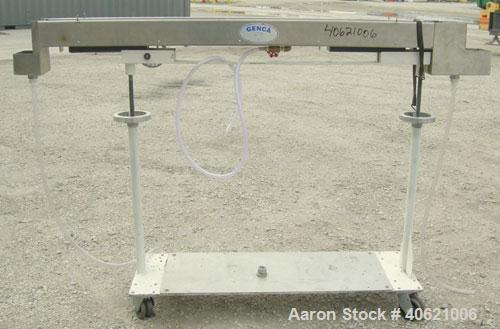 "Used- Genca Water Bath, stainless steel. 4"" wide x 60"" long x 3"" deep. Mounted on a carbon steel base with casters."