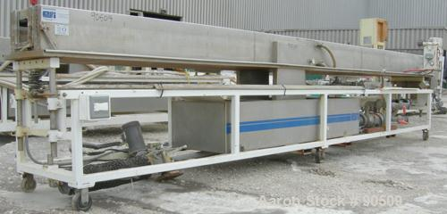 "Used: Extrusion Services Inc (ESI) spray cooling tank, 304 stainless steel. 16"" wide x 11"" deep x 20' long. (4) section top ..."