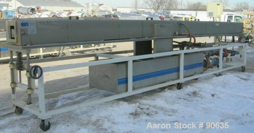 "Used: Extrusion Services Inc.(ESI) spray cooling tank, 304 stainless steel. 16"" wide x 11"" deep x 20' long.(4) section top c..."