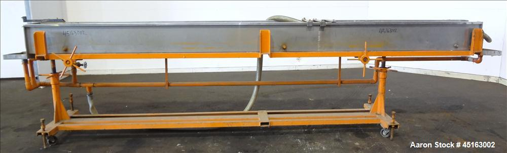 "Used- OEM Water Tank, 304 Stainless Steel, 185"" long x 12"" wide x 12"" deep. Mounted on a carbon steel frame with casters."