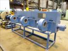 Used- Screw pellet cooling conveyor. Bottom perforated holes, top hinged cover, side mounted blowers.