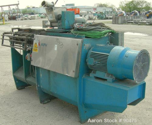 Used: APV twin screw extruder, 50mm screw diameter, model MPF50. Approximately 25:1 L/D ratio. Co-rotating screw design. 4 z...