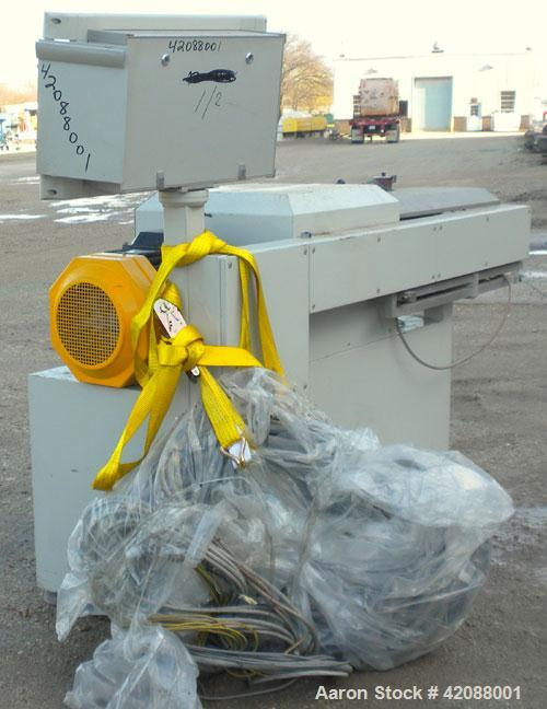 Used- APV Twin Screw Extruder, 50mm screw diameter. Approximately 15 to 1 L/D ratio. Co-rotating screw design. Vented, elect...