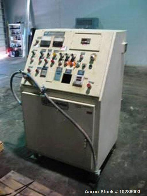 Used-Baker Perkins 100 mm twin screw compounding extruder. Segmented twin screws. 50 hp DC Siemens Allis main drive motor. B...