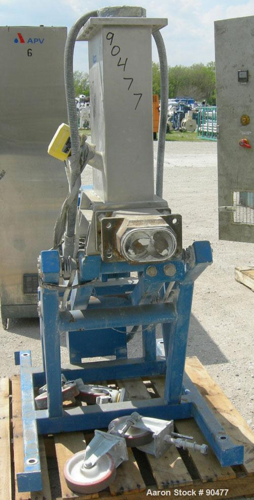 USED: K-tron twin screw side feeder, 80 mm, type K-T80-SF. Includes hopper. Driven by a 4kw (5.3 hp), 3/50/380/480 volt, 144...