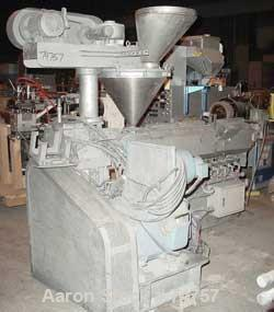 USED: NPC approximate 50mm twin screw extruder, model DMG50. Top vented barrel, electrically heated, water cooled, with tank...