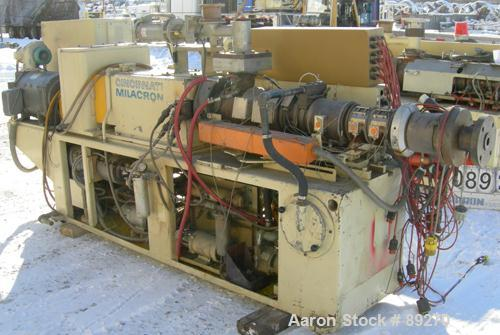 USED: Cincinnati conical counter-rotating twin screw extruder, 55 mm, model CM55. Approximate 20:1 L/D ratio. Approximate 48...