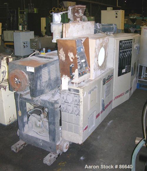 USED: Cincinnati Milacron twin screw extruder, model E55 Pinnacle. 55 mm conical screws, counter rotating, 21:1 L/D, electri...