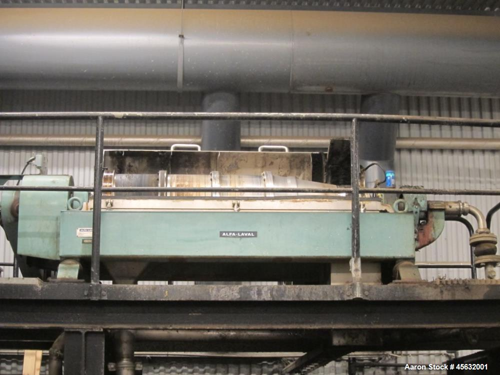Used- Cincinnati Milacron 65MM Counter-Rotating Conical Twin Screw Extruder, Model E65. Includes 50 hp AC motor with inverte...