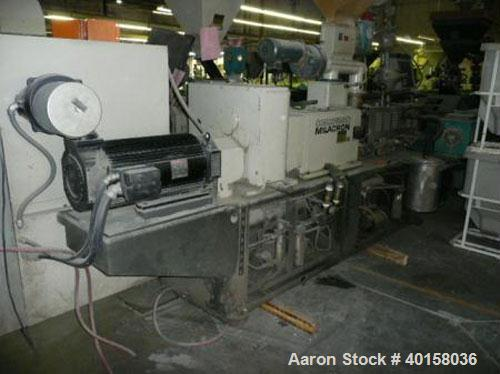 Used- Cincinnati Milicron Conical Counter-Rotating Twin Screw Extruder, 55 mm, model CM55HP. Electrically heated, water cool...