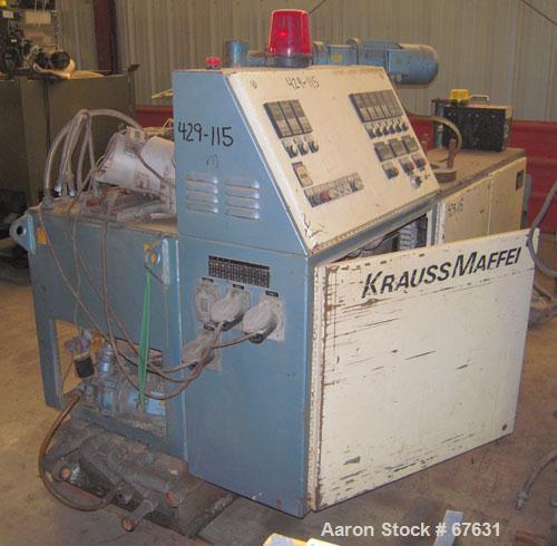 Used- Krauss Maffei 50mm Counter-Rotating Twin Screw Extruder, Type KMD-2-50KK. (2) 50 mm diameter screws. Dosing feeder. Ge...