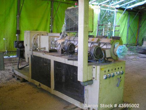 Used-Reifenhauser Twin Screw Extruder, Model BT-1000.  Conical screws, counter-rotating, 63 mm / 127 mm, vented barrel, vacu...