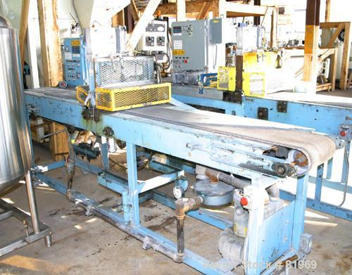 "USED: Guillotine cutter. (1) 13"" wide blade. Air operated single ram. Mounted on a table with a 12"" wide x 10' long rubber b..."