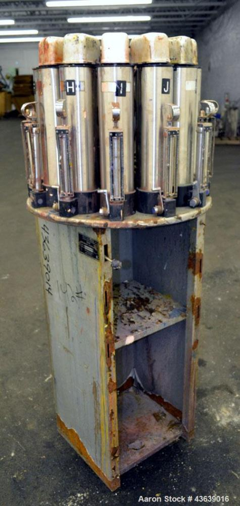Used- Harbil Manual Paint Colorant Dispenser, Model 10SC80232. (12) Canister.