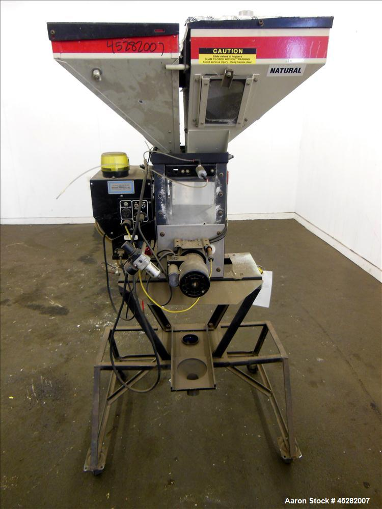 Used- McGuire 4 Color Weigh Scale Blender, Model W-140RM1. Mounted on a stand with casters. Serial# 89574.