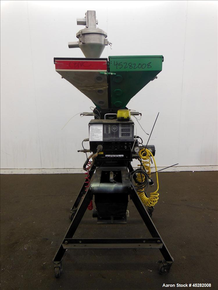 Used- McGuire 4 Color Weigh Scale Blender, Model W-140RM1. Mounted on a stand with casters. Serial# 89363.