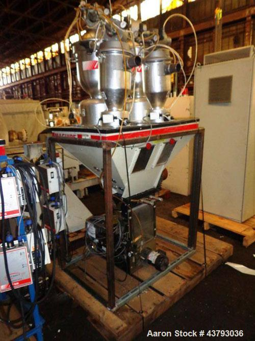 Used- Maguire 4 material volumetric blender, model WSB 440T, rated up to 1450 lbs/hr, with Mould Tek pneumatic vacuum loader...