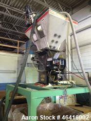"Used- Maguire 4 Material Gravimetric Blender, Model WSB 440.  Rated up to 1400 lbs/hr.  4-2"" x 3"" Slide Gate"