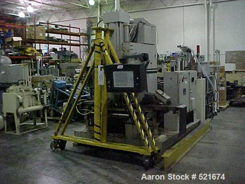"USED: 150 ton, 5 oz Autojector shuttle press, model HCS-150. New 1995. Mold clamping force 150 ton. Platen size 16"" x 20"". M..."