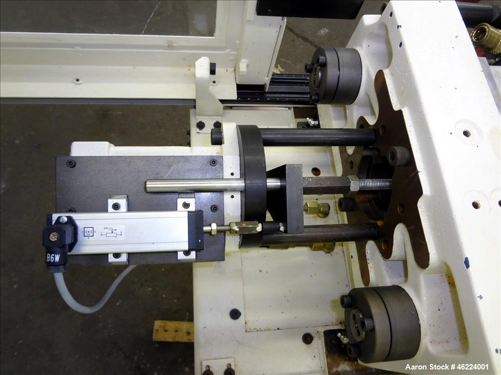 Used- Boy Injection Molder, Model 12M. Approximate 13 tons. 160 BAR. Distance Between Tie Bars 259mm. Tie Bar Diameter 35mm....