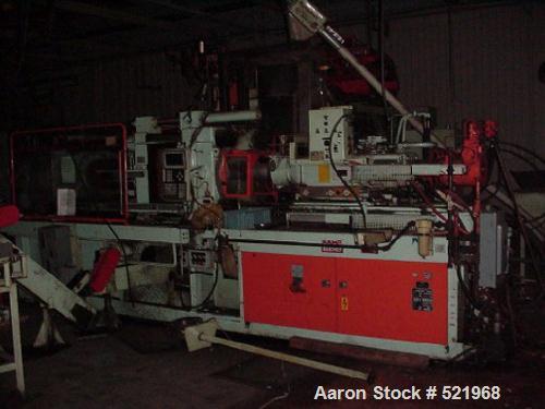 "USED: Bucher model S880/200, 200 ton. 29.9 cu in shot volume. 34"" x 34"" platen size, Siemens control, hopper. Mfg 1992."