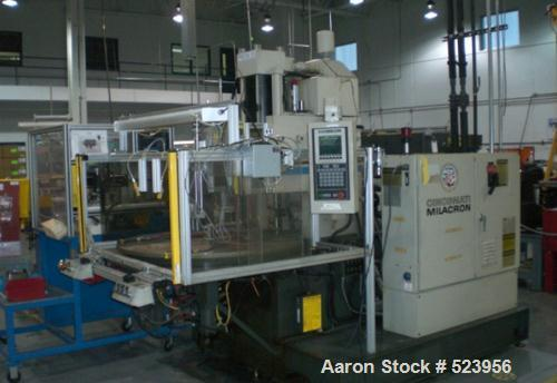 "USED: Cincinnati Milacron 70 ton, model CH-70-R, injection molding machine, 4.4 oz. Manufactured 1995. Platen size 10"" x 16""..."