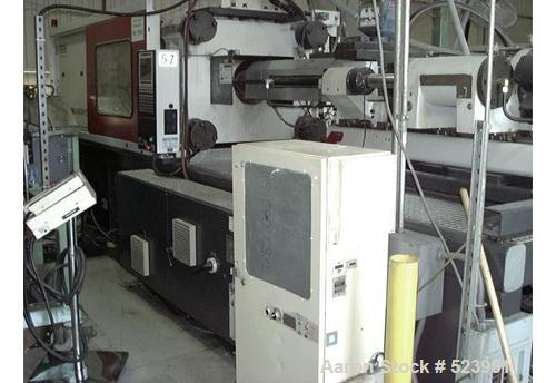 "USED: Cincinnati Milacron 310 ton, model MT310-29, injection molding machine, 26 oz. Clamp stroke 22.8"". Platen size 37"" x 4..."