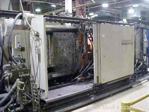 "USED: 1000 Ton, 140 ounce, Cincinnati Milacron injection molding machine, model VL1000-140. New 1994. Platen size 63"" x 63""...."