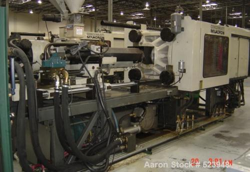 USED: Cincinnati Milacron 440 ton, model VT-440-54, injectionmolding machine, 54 oz. Manufactured 1995. Tie bar spacing 28.9...