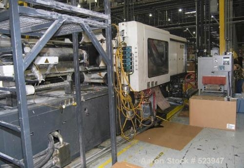 "USED: Cincinnati Milacron 550 ton, model VT550, injection moldingmachine, 76 oz. Manufactured 1999. Platen size 49.02"" x 49...."