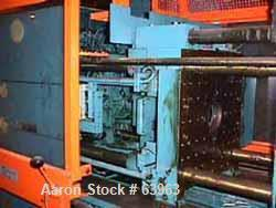 """USED: Demag 60 ton injection molding machine, model D60-151. Distance between tie bars 12-1/2"""", platen size 19-1/2"""" x 21-1/2..."""